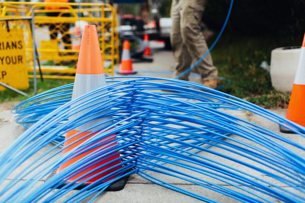 Blue fibre cable wrapped around witches hat